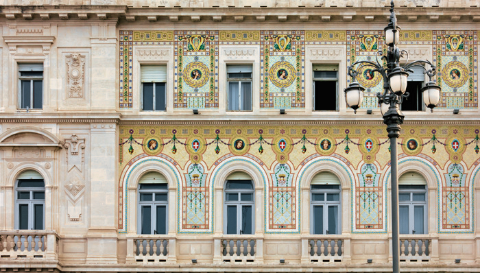 Neoclassic palace in daylight - Trieste, Italy